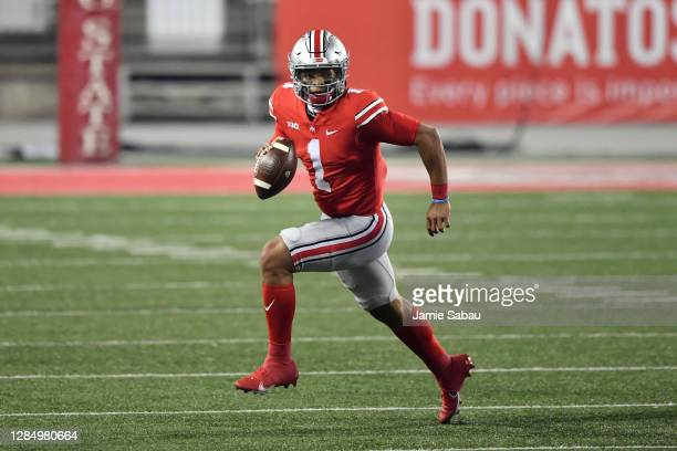 Quarterback Justin Fields of the Ohio State Buckeyes runs with the ball against the Rutgers Scarlet Knights at Ohio Stadium on November 7, 2020 in...