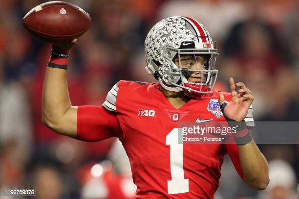 Quarterback Justin Fields of the Ohio State Buckeyes throws a pass during the PlayStation Fiesta Bowl against the Clemson Tigers at State Farm...