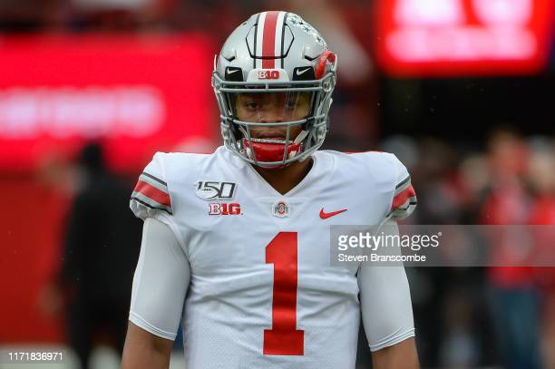 Quarterback Justin Fields of the Ohio State Buckeyes warms up before the game against the Nebraska Cornhuskers at Memorial Stadium on September 28...