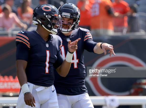 Quarterback Justin Fields talks with Quarterback Andy Dalton of the Chicago Bears talks before the game against the Cincinnati Bengals at Soldier...