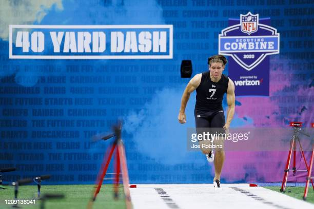 Quarterback Justin Herbert of Oregon runs the 40-yard dash during NFL Scouting Combine at Lucas Oil Stadium on February 27, 2020 in Indianapolis,...