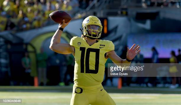 Quarterback Justin Herbert of the Oregon Ducks passes the ball during the second quarter of the qame against the Bowling Green Falcons at Autzen...