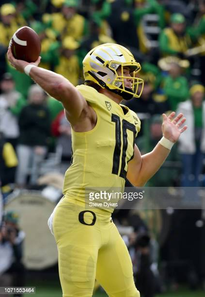 Quarterback Justin Herbert of the Oregon Ducks passes the ball during the first half of the game against the Oregon State Beavers at Reser Stadium on...