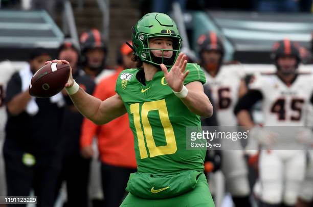 Quarterback Justin Herbert of the Oregon Ducks passes the ball during the first half of the game against the Oregon State Beavers at Autzen Stadium...