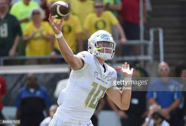 Quarterback Justin Herbert of the Oregon Ducks passes the ball during the first quarter of the game against the Nebraska Cornhuskers at Autzen...