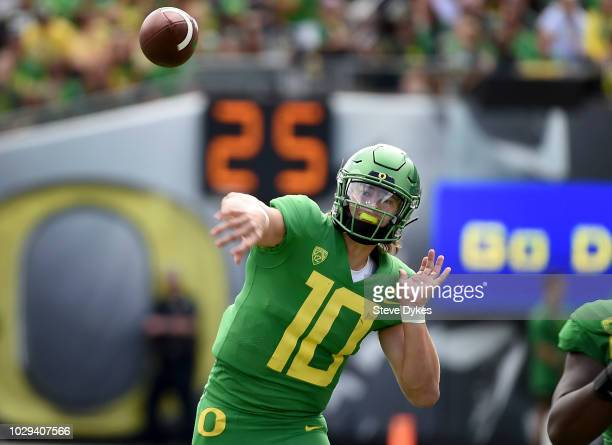 Quarterback Justin Herbert of the Oregon Ducks throws a pass during the second quarter of the game against the Portland State Vikings at Autzen...