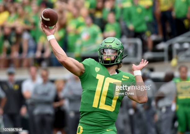 Quarterback Justin Herbert of the Oregon Ducks throws a touchdown pass during the first quarter of the game against the Portland State Vikings at...
