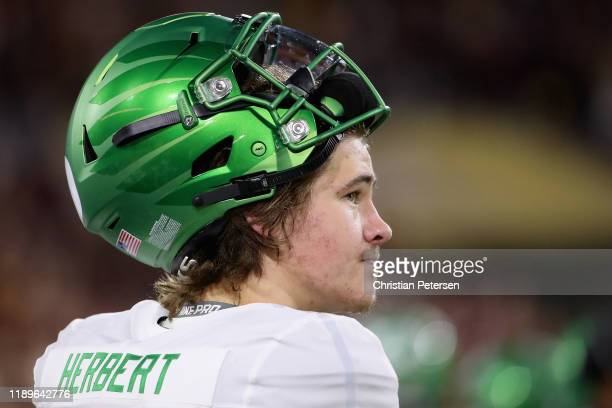 Quarterback Justin Herbert of the Oregon Ducks watches from the sidelines during the first half of the NCAAF game against the Arizona State Sun...