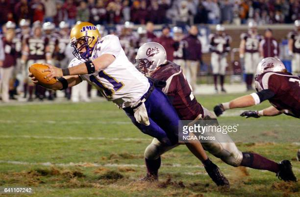 Quarterback Justin Rascati of James Madison dives across the goal line for a touchdown against Montana University during the Division 1AA Men's...