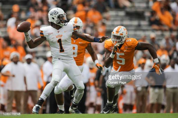 Quarterback Kai Locksley of the UTEP Miners looks to pass with Defensive lineman Kyle Phillips of the Tennessee Volunteers pressuring during the...