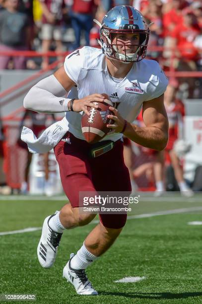 Quarterback Kaleb Barker of the Troy Trojans runs against the Nebraska Cornhuskers at Memorial Stadium on September 15 2018 in Lincoln Nebraska