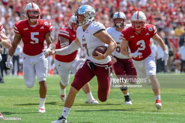 Quarterback Kaleb Barker of the Troy Trojans runs against the Nebraska Cornhuskers in the second half at Memorial Stadium on September 15 2018 in...