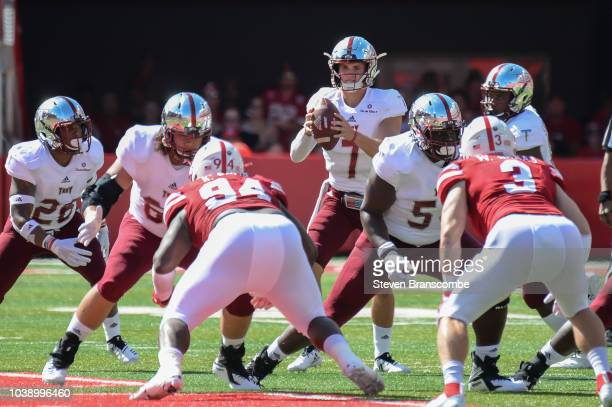 Quarterback Kaleb Barker of the Troy Trojans takes a snap against the Nebraska Cornhuskers at Memorial Stadium on September 15 2018 in Lincoln...