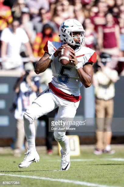 Quarterback Keenan Black of the Delaware State Hornets fades back on a pass play during the game against the Florida State Seminoles at Doak Campbell...