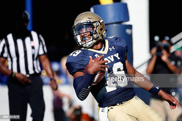 Quarterback Keenan Reynolds of the Navy Midshipmen celebrates after scoring a first half touchdown against the East Carolina Pirates on September 19...