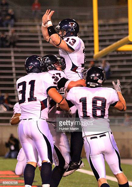 Quarterback Keiffer Garton of the Pennsylvania Quakers celebrates his touchdown with teammates during the game against the Princeton Tigers on...