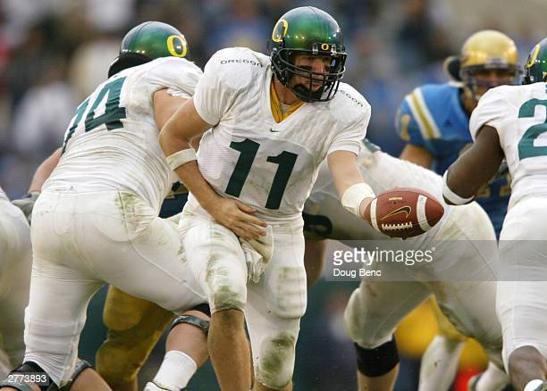 Quarterback Kellen Clemens of the Oregon Ducks hands the ball off during the game against the UCLA Bruins on November 15 2003 at the Rose Bowl in...