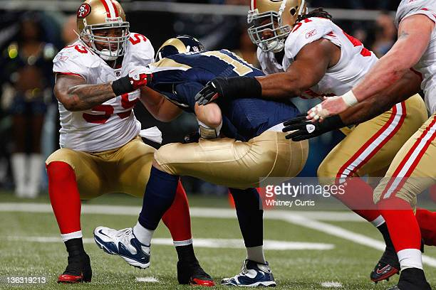 Quarterback Kellen Clemens of the St Louis Rams is sacked by outside linebacker Ahmad Brooks and defensive end Ray McDonald of the San Francisco...