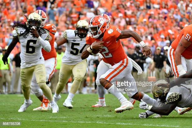 Quarterback Kelly Bryant of the Clemson Tigers breaks a tackle as he runs the ball but would leave the game with an ankle injury following this play...