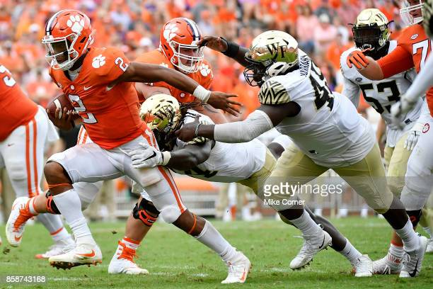 Quarterback Kelly Bryant of the Clemson Tigers breaks tackles as he runs the ball against the Wake Forest Demon Deacons during the game at Memorial...