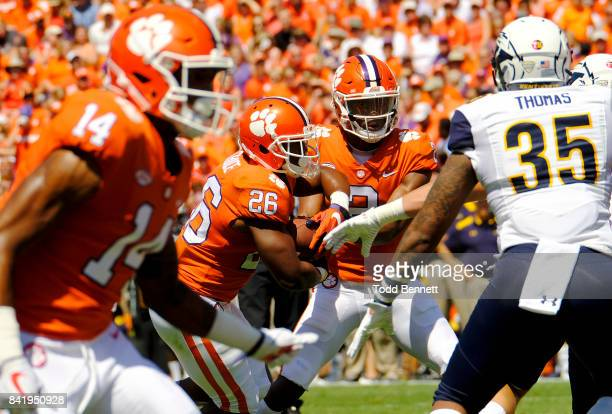 Quarterback Kelly Bryant of the Clemson Tigers hands off the ball to running back Adam Choice as they take on the Kent State Golden Flashes on...