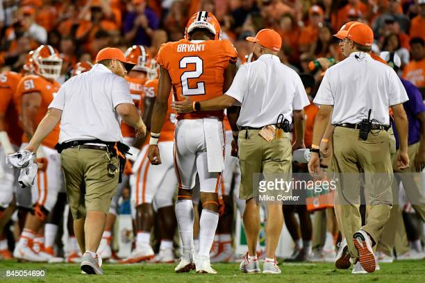 Quarterback Kelly Bryant of the Clemson Tigers is escorted off the field by the Clemson training staff after being shaken up on a play against the...
