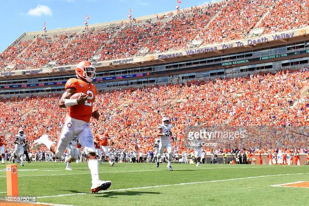 Quarterback Kelly Bryant of the Clemson Tigers runs in a 35 yard touchdown in the third quarter of the Tigers' football game against the Furman...