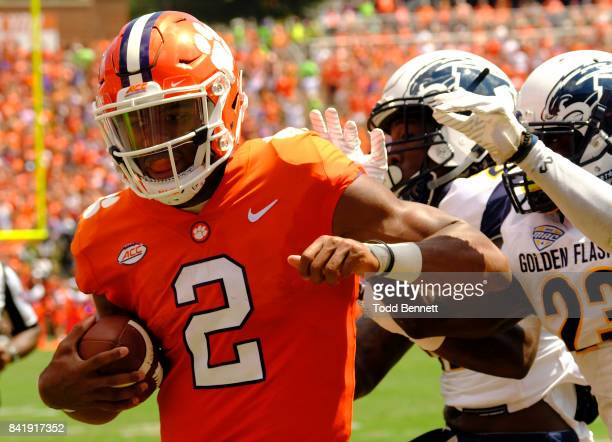 Quarterback Kelly Bryant of the Clemson Tigers scores a touchdown against the Kent State Golden Flashes on September 2 2017 at Memorial Stadium in...