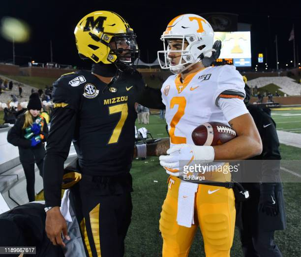 Quarterback Kelly Bryant of the Missouri Tigers and quarterback Jarrett Guarantano of the Tennessee Volunteers meet after their game at Faurot...