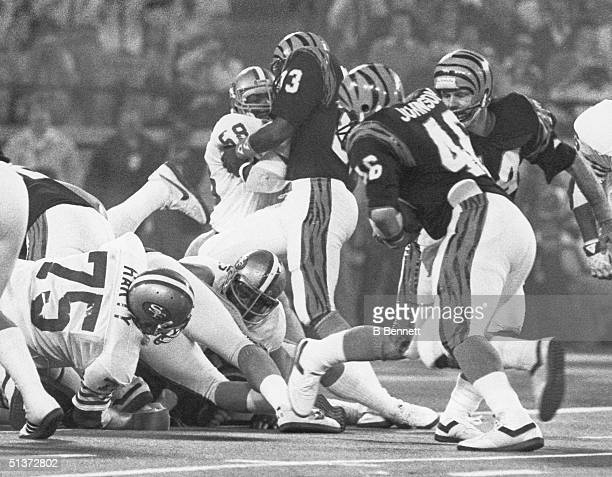Quarterback Ken Anderson of the Cincinnati Bengals hands off to teammate Pete Johnson against the San Francisco 49ers on Super Bowl XVI at the...