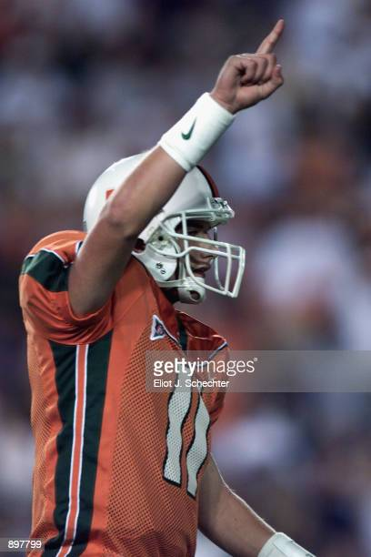 Quarterback Ken Dorsey of the Miami Hurricanes celebrates a touchdown in the third quarter against the Washington Huskies during the game at the...