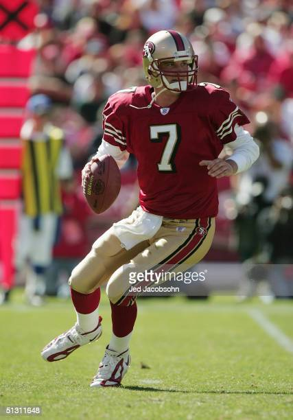 Quarterback Ken Dorsey of the San Francisco 49ers drops back to pass during the game against the Atlanta Falcons at 3Com Park on September 12, 2004...