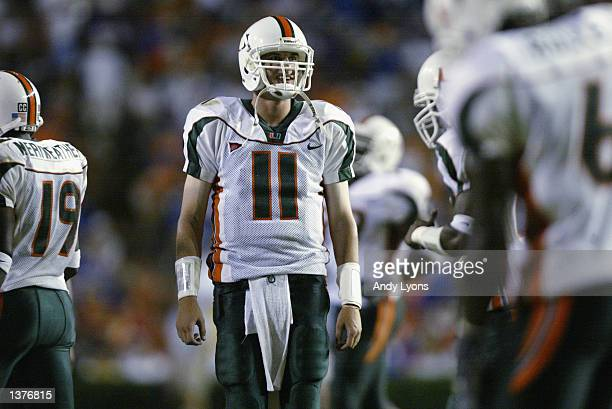Quarterback Ken Dorsey of the University of Miami looks on during the game against the University of Florida on September 7 2002 at Florida Field in...