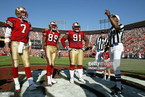 Quarterback Ken Dorsey, wide receiver Rasheed Marshall and defensive tackle Anthony Adams of the San Francisco 49ers watch the coin flip during the...