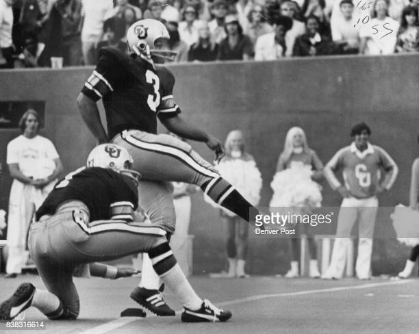 Quarterback Ken Johnson holds as Fred Lima puts bare foot into 45yard field goal in second quarter Credit Denver Post
