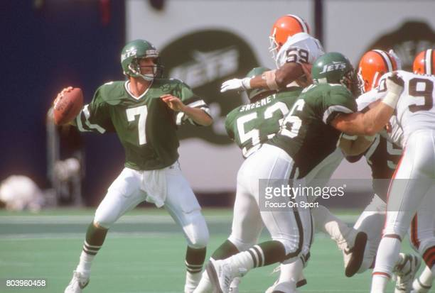 Quarterback Ken O'Brien of the New York Jets drops back to pass against the Cleveland Browns during an NFL football game September 16 1990 at Giants...