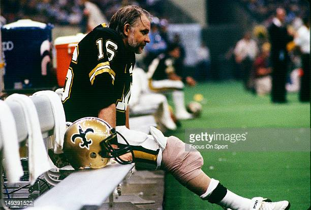 Quarterback Ken Stabler of the New Orleans Saints looks on from the bench during an NFL football game circa 1984 at the Louisiana Superdome in New...