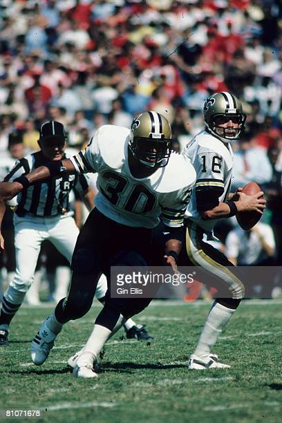 Quarterback Ken Stabler of the New Orleans Saints sets up to throw a pass as running back Wayne Wilson runs a pass pattern against the Atlanta...