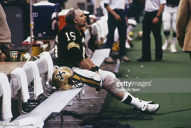 Quarterback Ken Stabler of the New Orleans Saints sits on the bench during a game circa 1990's