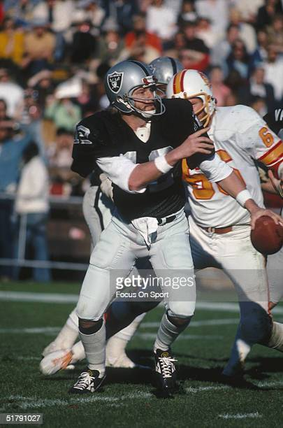 Quarterback Ken Stabler of the Oakland Raiders runs from the Tampa Bay Buccaneers.