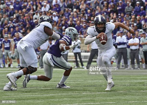 Quarterback Kenny Hill of the TCU Horned Frogs scrambles for a touchdown against the Kansas State Wildcats during the first half on October 14 2017...