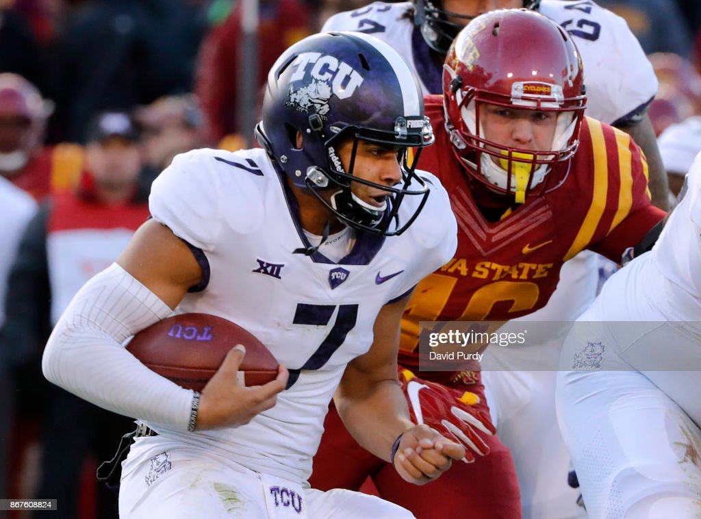 Quarterback Kenny Hill #7 of the TCU Horned Frogs scrambles for yards under pressure from defensive end Spencer Benton #46 of the Iowa State Cyclones in the second half of play at Jack Trice Stadium on October 28, 2017 in Ames, Iowa. The Iowa State Cyclones won 14-7 over the TCU Horned Frogs.