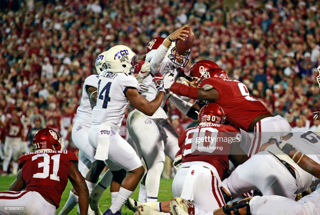 Quarterback Kenny Hill #7 of the TCU Horned Frogs stretches for a touchdown against the Oklahoma Sooners at Gaylord Family Oklahoma Memorial Stadium on November 11, 2017 in Norman, Oklahoma. Oklahoma defeated TCU