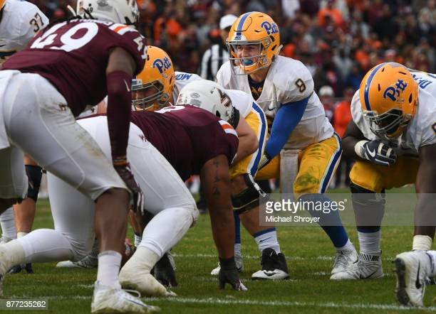 Quarterback Kenny Pickett of the Pittsburgh Panthers calls out a snap signal against the Virginia Tech Hokies in the second half at Lane Stadium on...