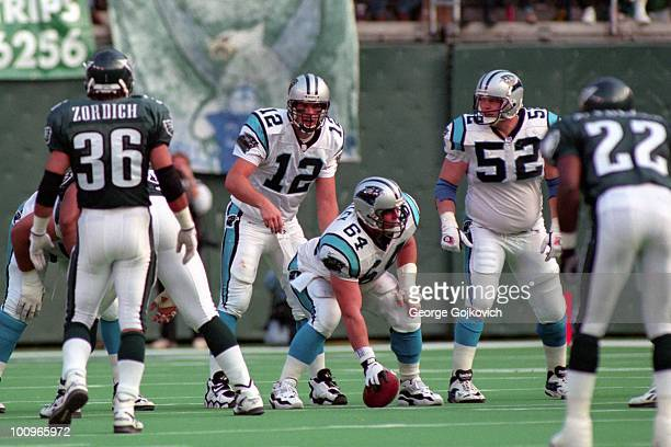 Quarterback Kerry Collins of the Carolina Panthers stands behind center Curtis Whitley and guard Matt Elliott during a game against the Philadelphia...