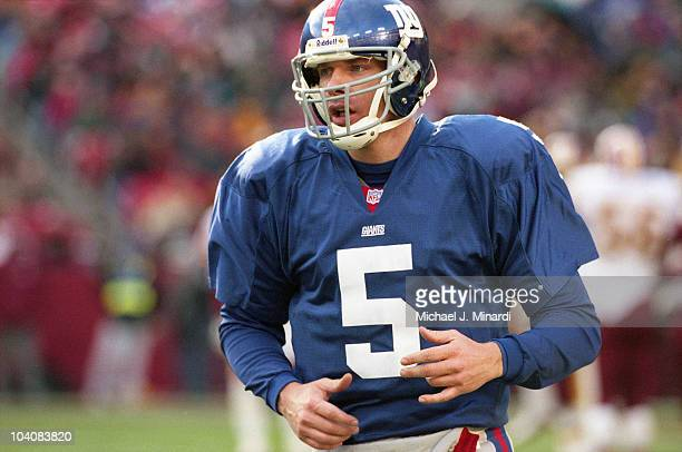 Quarterback Kerry Collins of the New York Giants jogs off the field to talk to the coach during a NFL game against the Washington Redskins at...