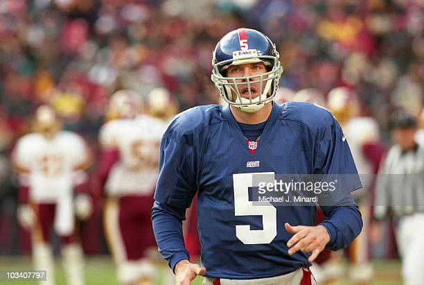 Quarterback Kerry Collins of the New York Giants ran off the field to talk to the Coach during a NFL game against the Washington Redskins at...