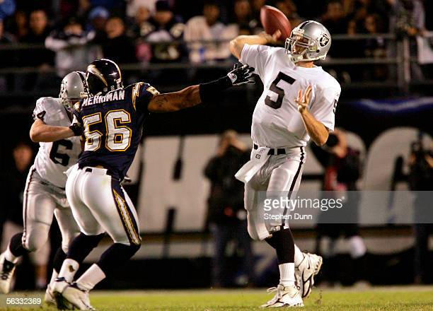 Quarterback Kerry Collins of the Oakland Raiders throws a pass as linebacker Shawne Merriman of the San Diego Chargers rushes on December 4 2005 at...