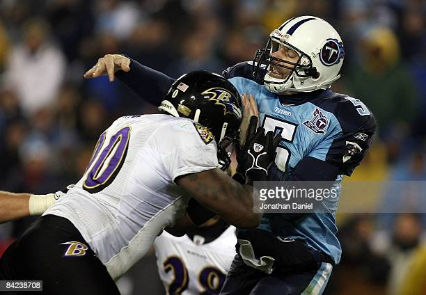 Quarterback Kerry Collins of the Tennessee Titans is hit as he throws the ball by tackle Trevor Pryce of the Baltimore Ravens during the AFC...
