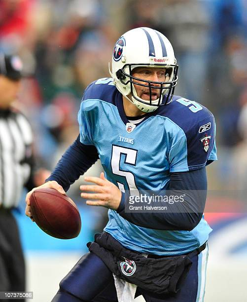 Quarterback Kerry Collins of the Tennessee Titans scrambles against the defense of the Jacksonville Jaguars during the game at LP Field on December 5...